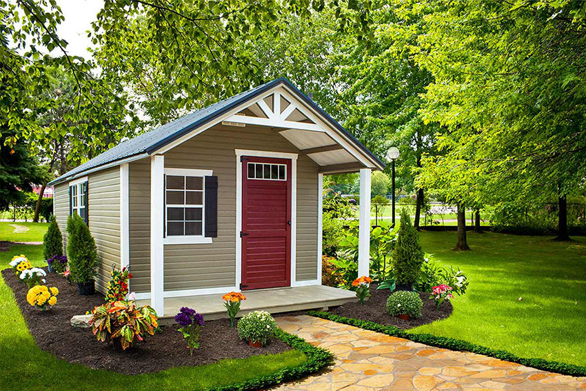 mini barn with beige siding and wegshell trim with navy roof